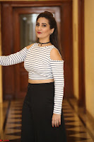 Manjusha in sleevelss crop top and black skirt at Darshakudu pre release ~  Exclusive Celebrities Galleries 061.JPG