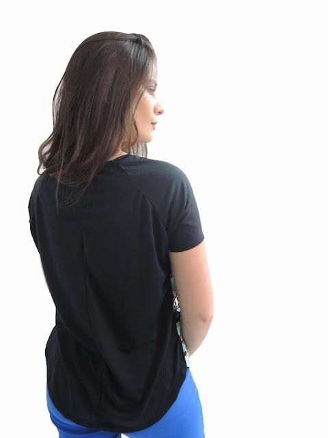 Blusa Bazz estampa frente na cor azul e na parte de trás preta lisa
