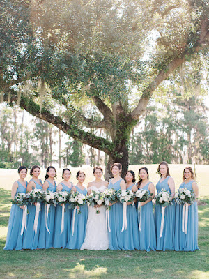 bride and bridesmaids in blue with white bouquets