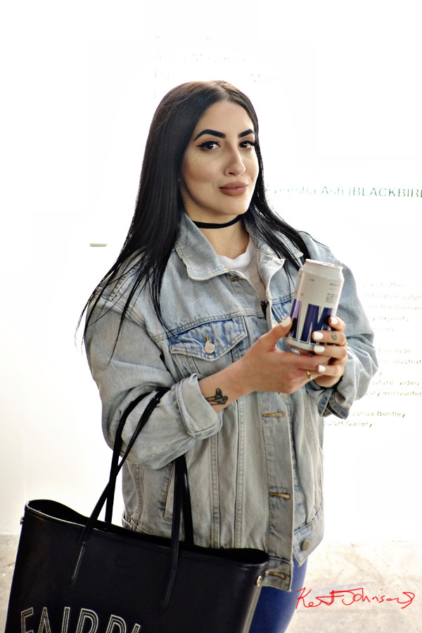 Black hair, make-up faded, denim jacket. Spring Fashion Ambushed by Street Fashion Sydney. Photographed by Kent Johnson.