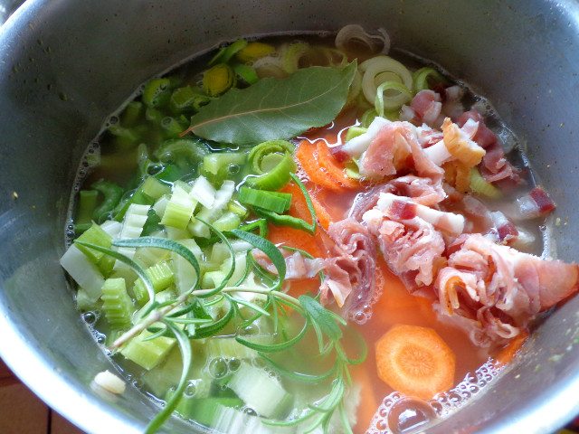 Add pancetta, prosciutto, olive oil, carrots, celery, leeks, bay leaf and rosemary