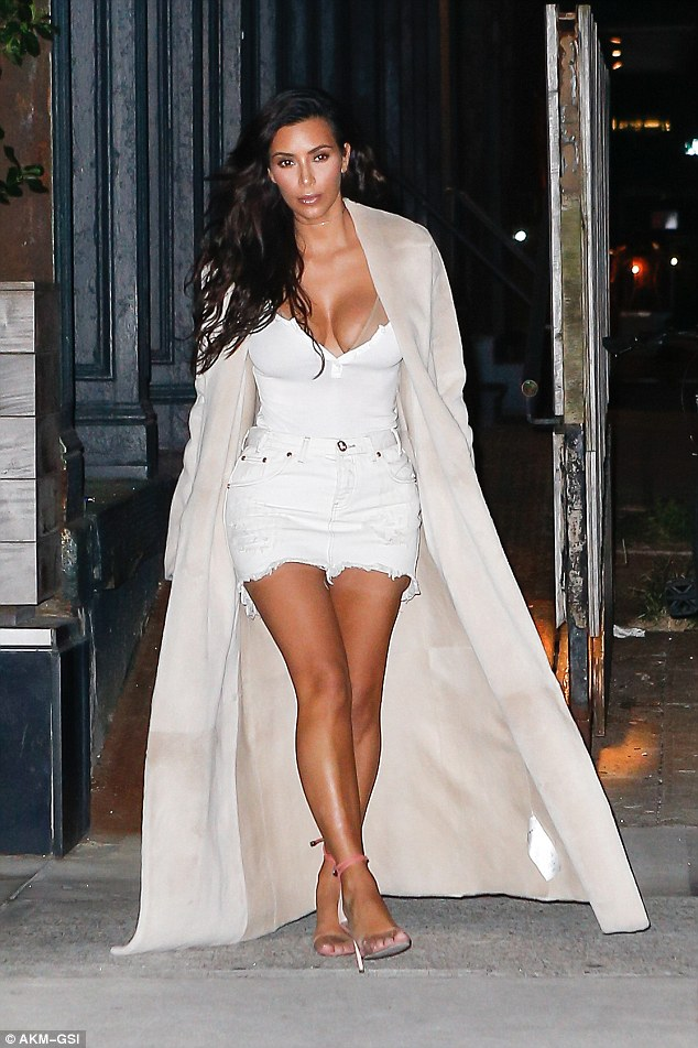Kim Kardashian steps out in plunging top and denim skirt for date night