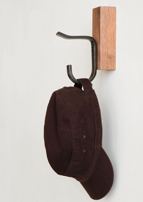 steel hook on walnut wood block