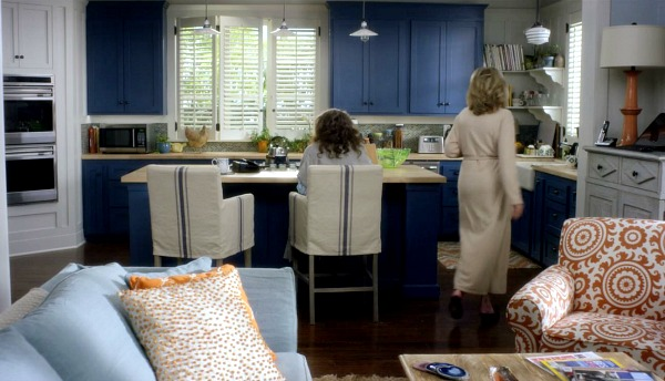Grace and Frankie beach house kitchen with blue cabinets and barstools. #graceandfrankie #bluecabinets