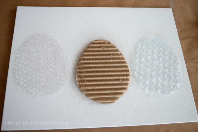 cut out egg stamps from cardboard and bubble wrap