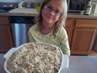 Little Miss with her very own peach blueberry crisp