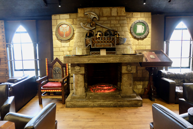 The fireplace in Bugman's Bar