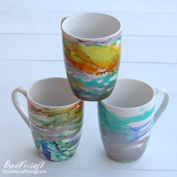 Alcohol ink art on ceramic mugs make the perfect handmade gift! These are perfect for all skill levels from beginner to expert. Alcohol ink is the latest craft trend and you will love it--plus mugs are a gift that keep giving. Make an alcohol ink art piece on a ceramic mug with a full video tutorial.