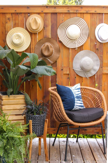 Easy five minute dollar store summer decorating idea - hat wall
