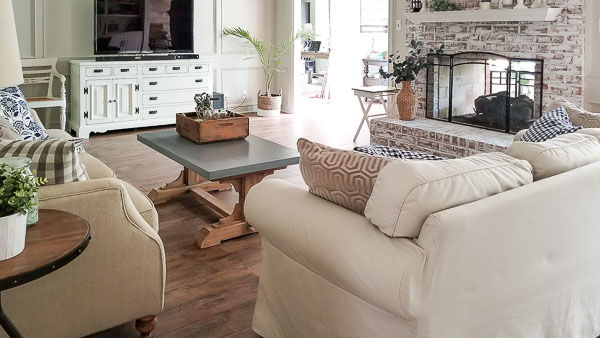 living room with white chalk painted fireplace