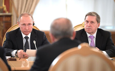 Vladimir Putin with Presidential Aide Yury Ushakov at the sixth meeting of the High-Level Russian-Turkish Cooperation Council.