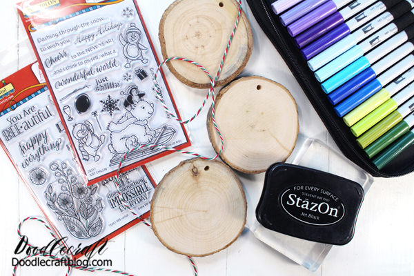 Supplies Needed for Wood Slice Ornaments: Wood slices Tombow ABT PRO Alcohol-Based Markers Dare 2B Artzy Stamps (10% off with code: FALL10) Black ink (I used Stazon) Acrylic block Bakers Twine