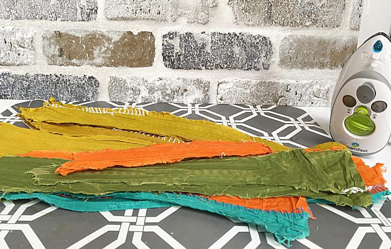 ironed fabric scraps for pumpkin pillow