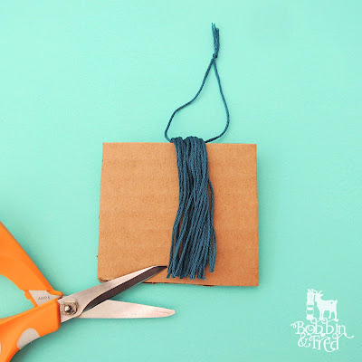 How to make a tassel tutorial, step 3, cut the thread along the bottom