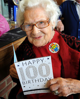 Photo of elderly lady with happy 100 birthday card