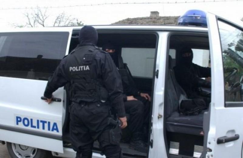 Percheziție domiciliară efectuată de polițiști