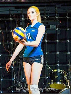 Alice Manenok is exercising on the volleyball court