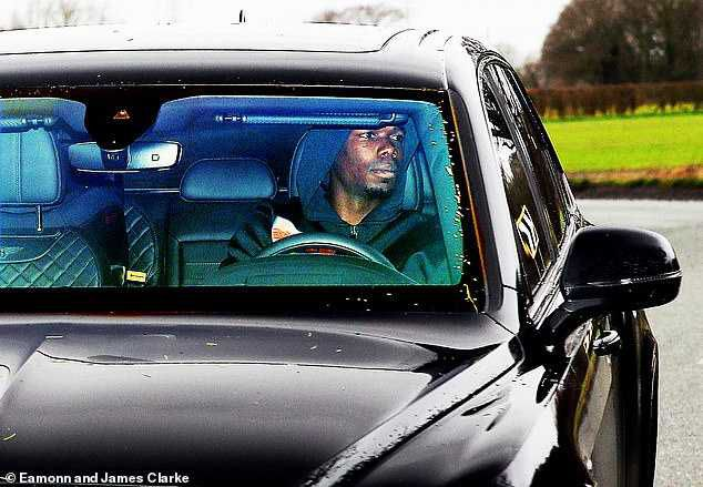 Paul Pogba Finally Arrives BACK At Manchester United Training Base (Photos)