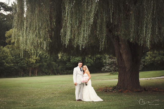 bride and groom under willow tree at Fern Hill Golf Course