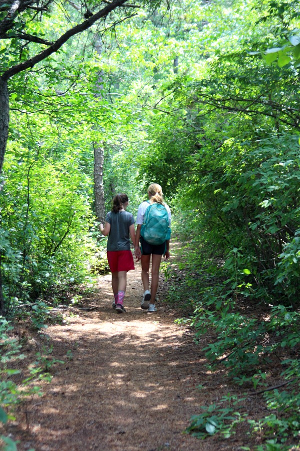 The Girls Walked And Talked As They Strolled Along The Nice And Well Marked  Trail Paths.
