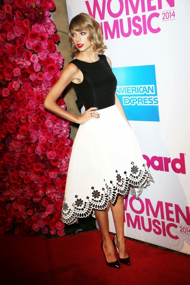 Taylor Swift in a white leather skirt at the 2014 Billboard Women in Music Luncheon in NYC