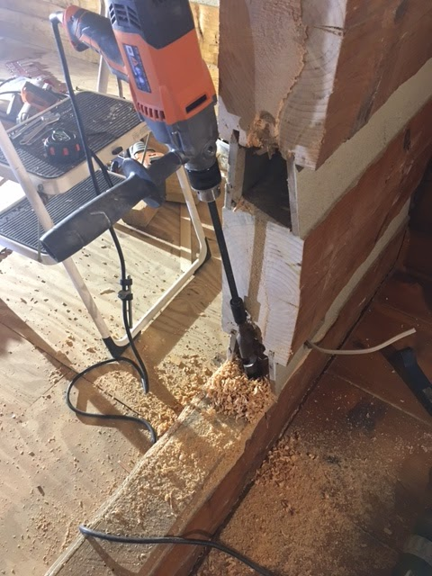 log_cabin_wall_moving_electrical_wires_drilling_ridgid_drill