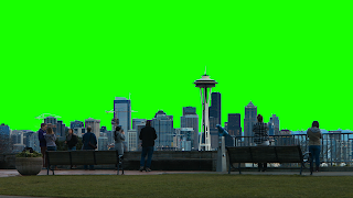 A free video of downtown Seattle skyline & people in a park set against a green screen background.