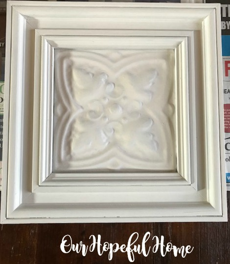 white painted framed ceiling tile wall art