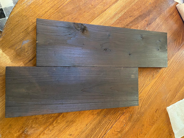 Photo of two dark stained boards