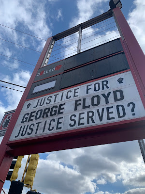 """Photo of gas station sign that says """"Justice Served?"""""""