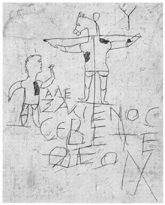 """Древноримски графит гласящ: """"Алексаменос се покланя на своя бог"""". Разпънатото магаре е олицетворение на Христос"""