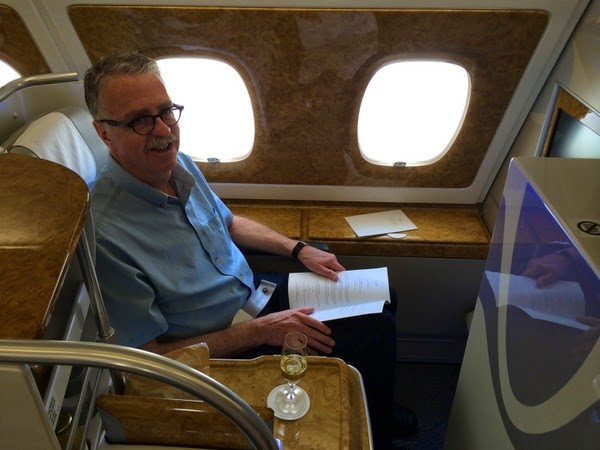 customer John Briggs in Business Class on Emirates A380 aircraft