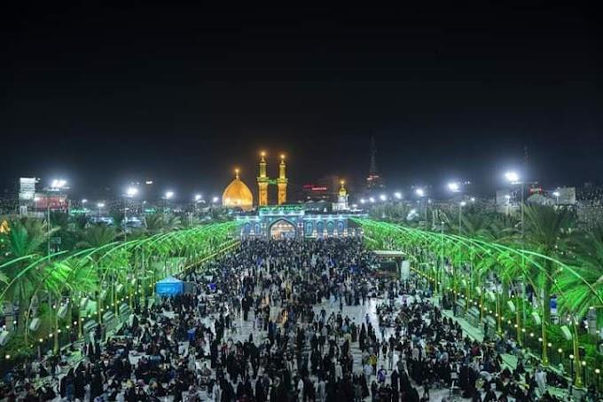 بالصور.. مراسم استبدال راية قبة الإمام الحسين في كربلاء