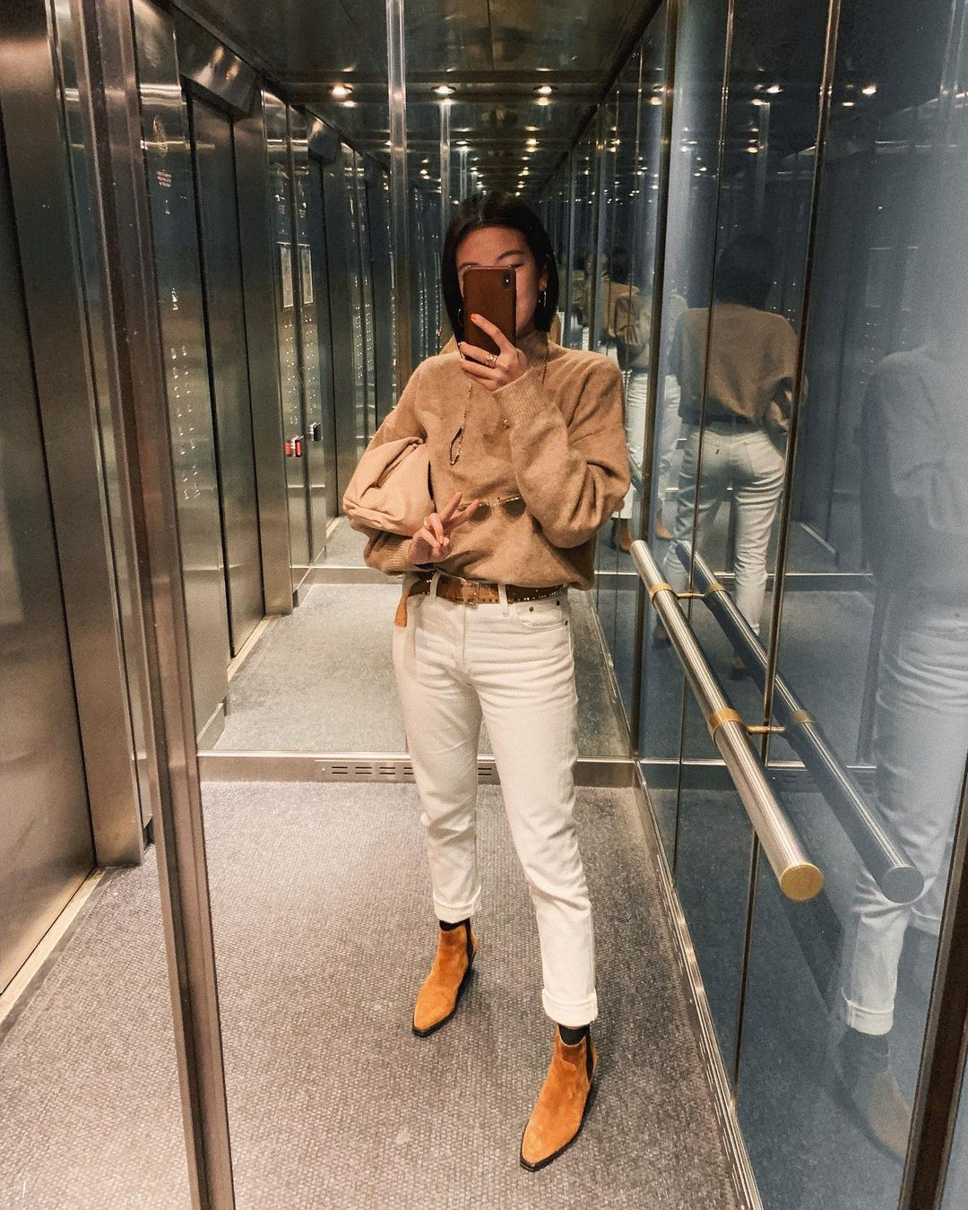 How to Style a Simple Neutral Outfit for Fall — @jessundecided instagram look with tan sweater, white jeans, and camel ankle boots