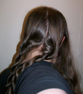 Back hair twisted into two ropes.