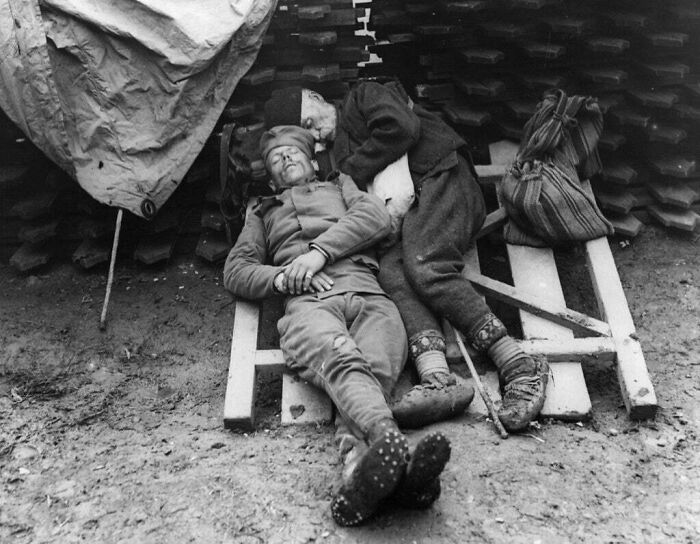 #10 A Serbian Soldier Sleeps With His Father Who Came To Visit Him On The Front Line Near Belgrade, 1914/1915