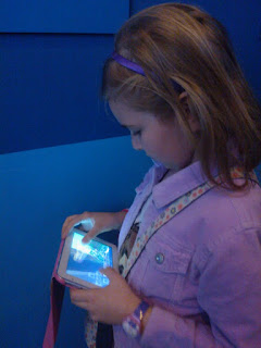 Top Ender playing Minecraft on her Tablet
