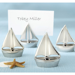 https://www.partycity.com/silver-sailboat-place-card-holders-454140.html?cgid=summer-decorations