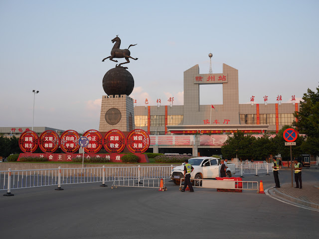 man driving truck stopped by police at the Ganzhou Railway Station