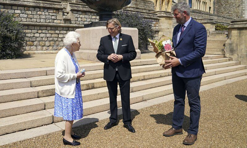 Queen Elizabeth has received a commemorative rose to mark what would have been the 100th birthday of the Duke of Edinburgh