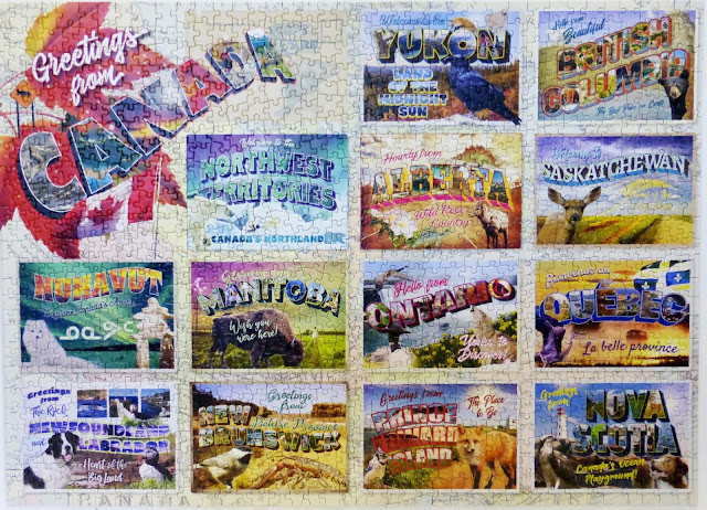 Elmer Prather assembled puzzle of Greetings from Canada