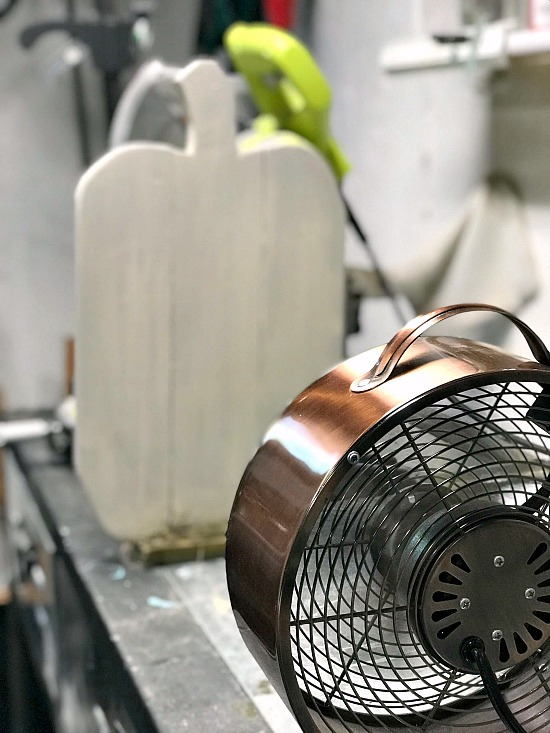 White pallet pumpkin drying by the fan