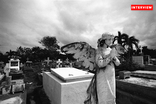 A praying Angel in a cemetery in Cuba photo by Marlon Krieger