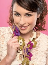 http://www.letsknit.co.uk/free-knitting-patterns/crochet_flower_scarf