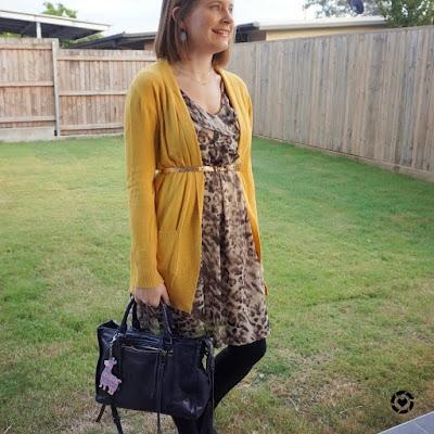 awayfromblue Instagram | witner office otufit belted mustard yellow cardigan with animal print ruffle dress regan bag
