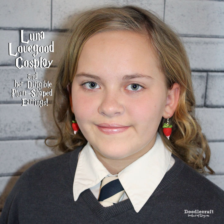 Harry Potter inspired Luna Lovegood cosplay or Halloween costume with dirigible plum earrings or radish earrings made of polymer clay.