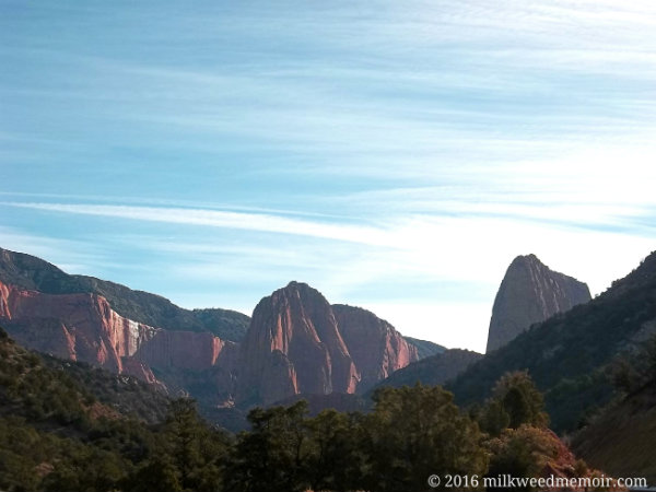 Three tall sandstone mesas jut up majestically ahead in morning light, justifying the name of this Zion National Park, Utah, name: Kolob Canyon, home of God.