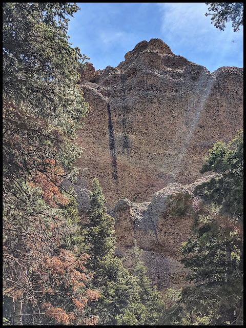 Vertical Cliff wall all made up of Large River Rocks that have been naturally cemented together.  Mind Baffling!