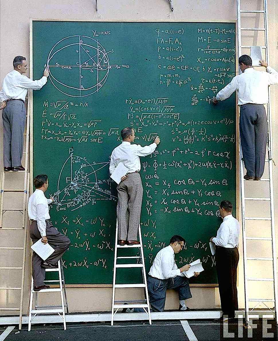 a photograph of scientists working on equations at a giant chalk board