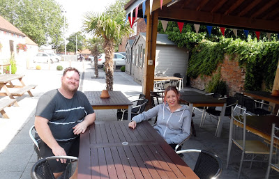 Andy and Tracey Noon - new mine hosts at the Black Bull pub in Brigg - enjoying the sunshine in July 2019